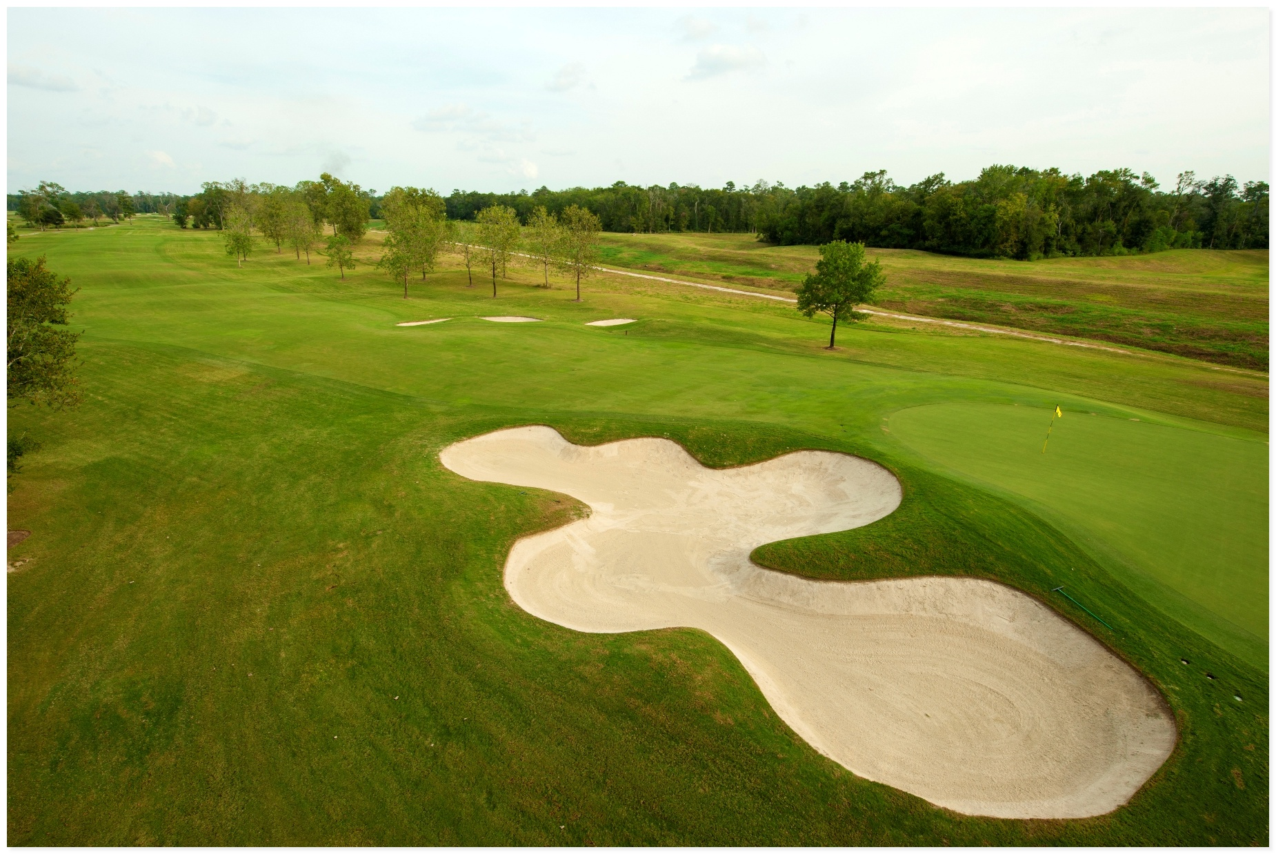 View of entire hole layout featuring straight fairway and flat green