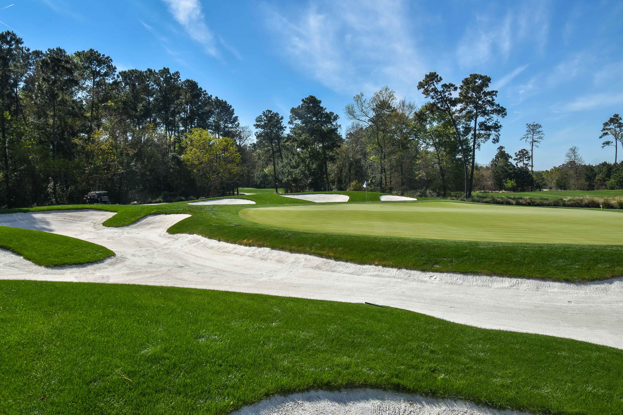 White sand bunker featured behind green